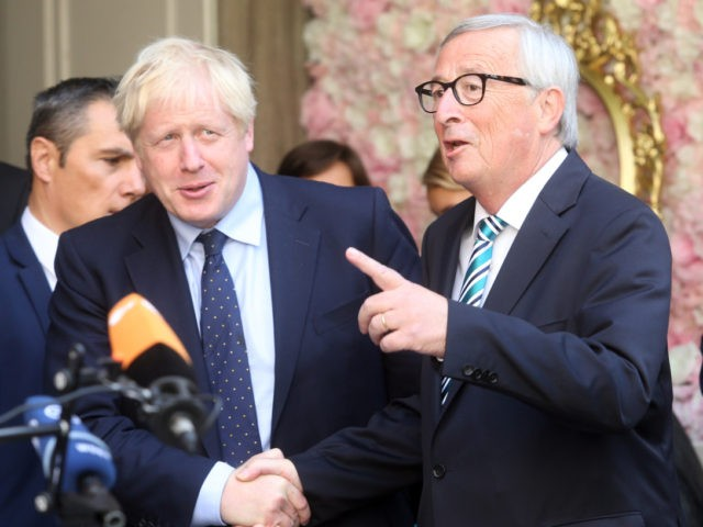 EU Commission president Jean-Claude Juncker (R) welcomes British Prime Minister Boris Johnson (L) prior to their meeting, on September 16, 2019 in Luxembourg - Six weeks before he is due to lead Britain out of the European Union, Prime Minister Boris Johnson meets Jean-Claude Juncker, insisting that a Brexit deal …