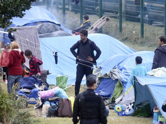 People leave the Grande Synthe migrant camp during its evacuation by French gendarmes on September 17, 2019 in Grande-Synthe, northern France. (Photo by FRANCOIS LO PRESTI / AFP) (Photo credit should read FRANCOIS LO PRESTI/AFP/Getty Images)