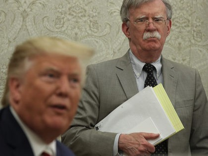 WASHINGTON, DC - AUGUST 20: U.S. President Donald Trump speaks to members of the media as National Security Adviser John Bolton listens during a meeting with President of Romania Klaus Iohannis in the Oval Office of the White House August 20, 2019 in Washington, DC. This is Iohannis' second visit …