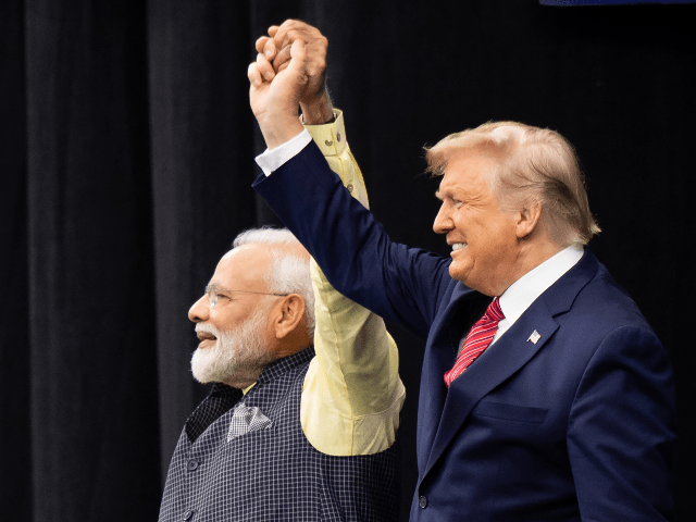 "US President Donald Trump and Indian Prime Minister Narendra Modi attend ""Howdy, Modi!"" at NRG Stadium in Houston, Texas, September 22, 2019. - Tens of thousands of Indian-Americans converged on Houston on Sunday for an unusual joint rally by Donald Trump and Narendra Modi, a visible symbol of the bond …"
