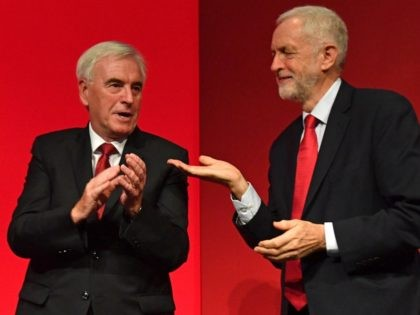 Britain's main opposition Labour Party Leader Jeremy Corbyn (R) gestures to Labour party's shadow Chancellor John McDonnell (L) on stage after McDonnell's speech during the Labour party conference in Brighton, on the south coast of England on September 23, 2019. - Britain's main opposition Labour Party was set Monday to …