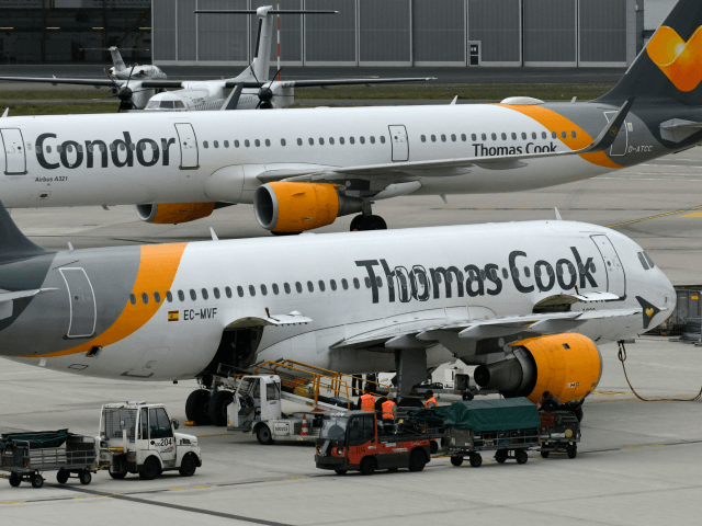 An airplane of British tour operator Thomas Cook (front) and another one of Condor, the German airline subsidiary of the British travel giant, are seen on September 24, 2019 at the airport in Duesseldorf, western Germany. - As British tour operator Thomas Cook declared bankruptcy, some 600,000 tourists from around …