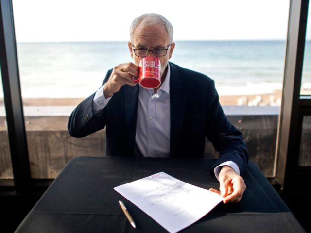 "Britain's main opposition Labour Party Leader Jeremy Corbyn takes a drink as he poses for a photograph preparing his speech during the annual Labour Party conference in Brighton, on the south coast of England on September 24, 2019. - Britain's Supreme Court on Tuesday ruled ""unlawful"" a decision by Prime …"