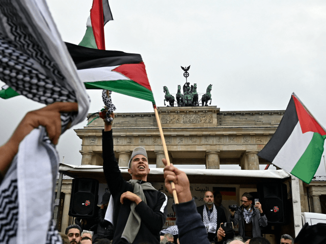 "People wave Palestian flags at the Brandenburg Gate during a pro-Palestinian rally in Berlin on September 25, 2019. - Berlin authorities barred a planned appearance by two rappers during a pro-Palestinian rally at the Brandenburg Gate on the grounds of ""anti-Semitic messages"" in their lyrics. (Photo by Tobias SCHWARZ / …"