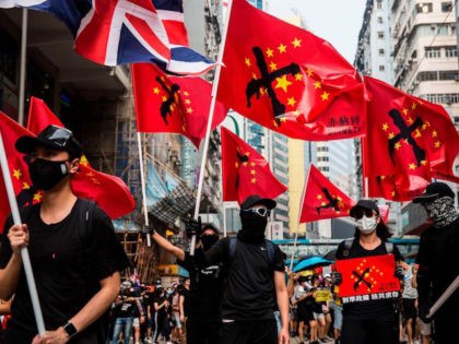 Thousands of people hold an unsanctioned protest march through the streets of Hong Kong on September 29, 2019. - Thousands of Hong Kongers defied police tear gas rounds on September 29 to hold an unsanctioned march through the city, part of a coordinated day of global protests aimed at casting …