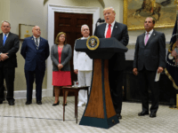 U.S. President Donald Trump (2nd R) announces the $1.8 billion State Opioid Response Grants with (L-R) Director of the White House Office of National Drug Control Policy James Carroll, Director of the Centers for Disease Control and Prevention Dr. Robert Redfield, Assistant Secretary for Mental Health and Substance Use Dr. …