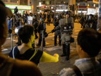 People scream at the police as they guard a street before dispersing a crowd of residents and protesters after they gathered outside the Mong Kok Police Station on September 07, 2019 in Hong Kong, China. Pro-democracy protesters have continued demonstrations across Hong Kong despite the withdrawal of a controversial extradition …
