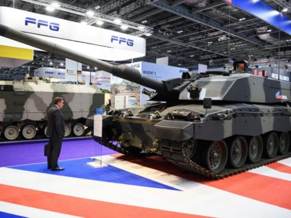 LONDON, ENGLAND - SEPTEMBER 11: A delegate studies a Challenger II tank on day two of the DSEI arms fair at ExCel on September 11, 2019 in London, England. The biennial Defence and Security Equipment International (DSEI) is the world's largest arms fair and is held in London's Docklands area. …
