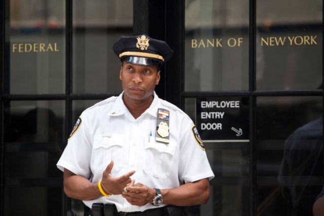 NEW YORK, NY - JULY 29: A Federal Reserve police officer stands guard outside the entrance to the Federal Reserve Bank of New York, located at 33 Liberty Street, on July 29, 2011 in New York City. Bankers and economists were invited to meet with Treasury Department officials at the …