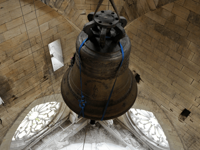 Employees work to hang the new tenor bell at the Orleans cathedral, western France on November 9, 2012. AFP PHOTO/ ALAIN JOCARD (Photo credit should read ALAIN JOCARD/AFP/Getty Images)