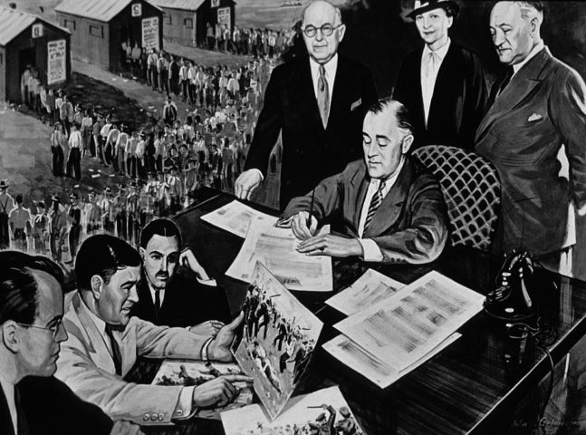 1935: 32nd President of the United States Franklin Delano Roosevelt (1882 - 1945) signs the National Labor Relations Act. (Photo by MPI/Getty Images)