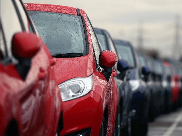 Cars are prepared for distribution at a Ford factory on January 13, 2015 in Dagenham, England. Originally opened in 1931, the Ford factory has unveiled a state of the art GBP475 million production line that will start manufacturing the new low-emission, Ford diesel engines from this November this will generate …