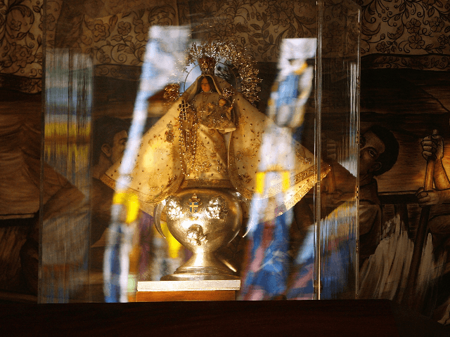 """A replica statue of the 400-year-old """"La Virgen de la Caridad del Cobre"""" is on display in the National Shrine of Our Lady of Charity August 6, 2006 in Miami, Florida. Built in 1966, the shrine houses a replica of the 400-year-old statue of Virgin of Charity and is a …"""