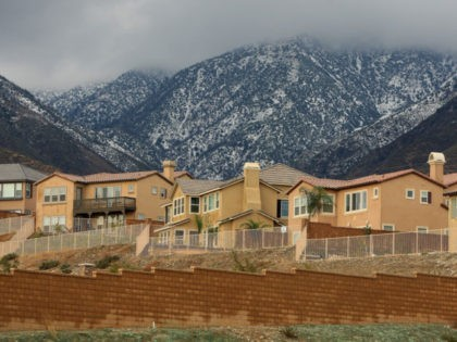 RANCHO CUCAMONGA, CA - DECEMBER 16: Storm clouds hover near recently finished homes and unfinished home lots during a break between storms after the dwindling new home sales market brought construction to a halt at a new home development December 16, 2008 in Rancho Cucamonga, California. Home construction took its …