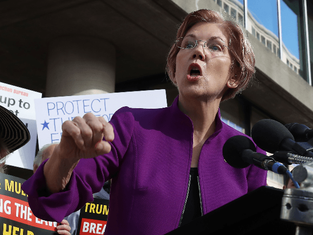 Sen. Elizabeth Warren (D-MA) speaks during a protest in front of the Consumer Financial Protection Bureau (CFPB) headquarters on November 28, 2017 in Washington, DC. Sen. Warren is demanding that Mick Mulvaney step aside and let acting CFPB director Leandra English do her job. President Trump named Office of Management …