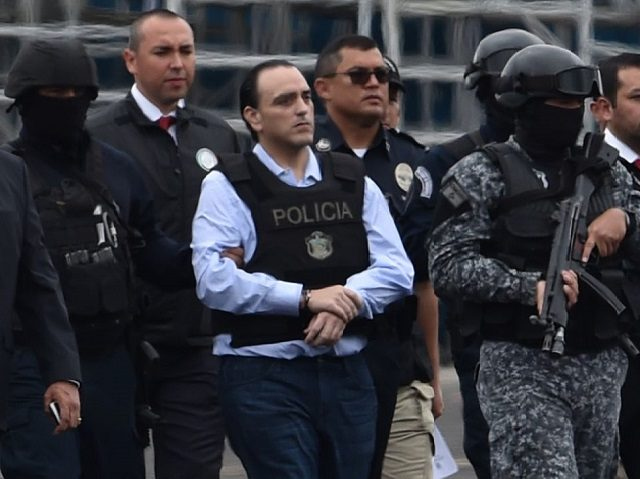 The former governor of the Mexican state of Quintana Roo, Roberto Borge (C) is escorted by the police during his extradition to Mexico, at Panama City's Tocumen international airport on January 4, 2018. Panama extradited former Mexican state governor Roberto Borge to Mexico to face charges of alleged graft, the …