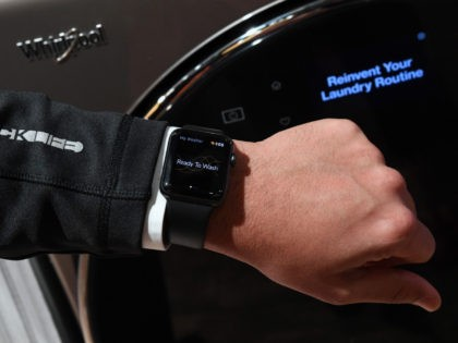 LAS VEGAS, NV - JANUARY 09: An Apple Watch is displayed in front of a new USD 1,699 Whirlpool All-In-One Washer and Dryer at the Whirlpool booth during CES 2018 at the Sands Expo and Convention Center on January 9, 2018 in Las Vegas, Nevada. The washer-dryer syncs up notifications …