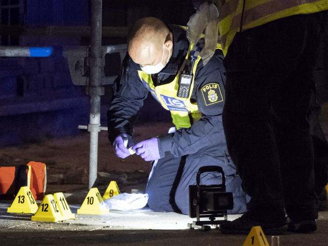 Policemen search the scene after five people were hurt in a shooting in the centre of the southern Swedish city of Malmo on June 18, 2018. - One person was killed and five wounded in a shooting in the centre of the southern Swedish city of Malmo, police said, ruling …