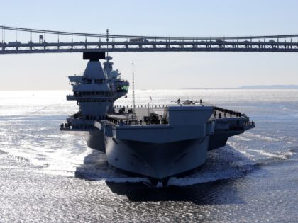 NEW YORK, NY - OCTOBER 19: Britain's new aircraft carrier HMS Queen Elizabeth arrives in New York on October 19, 2018 in New York City. The Royal Navy's £3.1bn aircraft carrier, HMS Queen Elizabeth is sailing into New York for a week-long visit, as part of her US deployment, following …