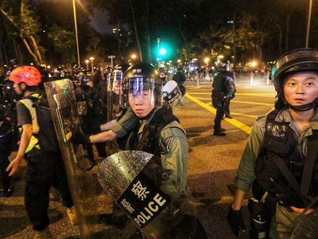 Riot police push back the press as they isolate and search protesters in Causeway Bay in Hong Kong on September 8, 2019. - Riot police on September 8 chased groups of hardcore protesters who blocked roads, vandalised nearby subway stations and set makeshift barricades on fire as the evening set …