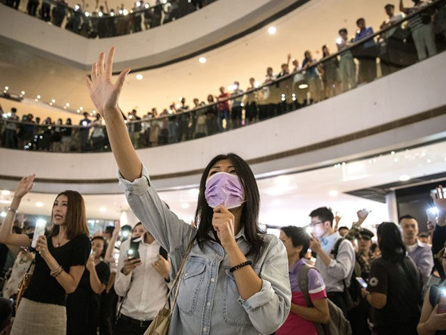 HONG KONG, CHINA - SEPTEMBER 12: Protesters sing songs and shout slogans after gathering at the IFC Mall on September 12, 2019 in Hong Kong, China. Pro-democracy protesters have continued demonstrations across Hong Kong despite the withdrawal of a controversial extradition bill as demonstrators call for the city's Chief Executive …