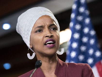 "Rep. Ilhan Omar, D-Minn., respond to remarks by President Donald Trump after his call for the four Democratic congresswomen to go back to their ""broken"" countries, during a news conference at the Capitol in Washington, Monday, July 15, 2019. All are American citizens and three of the four were born …"