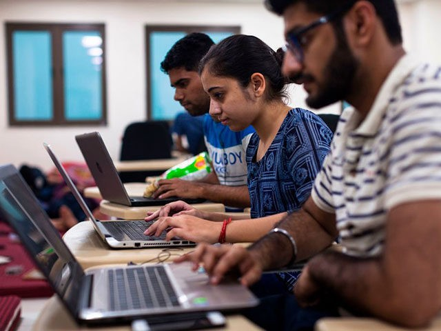Indian undergraduate students code on their computers as they take part in HackCBS, a 24 hour event of software development also called 'hackathon', at the Shaheed Sukhdev College of Business Studies (SSCBS) in New Delhi on October 28, 2018. - Students from all over India gathered in teams to take …