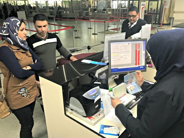 Samah Yousef, second from left, and his wife, Mariam Ali, left, Iraqis who were prevented from boarding a flight to United State a few days ago, prepare to board a flight bound for Egypt on Monday, on their way to the United States in Baghdad airport, Iraq, Monday, Feb. 6, …