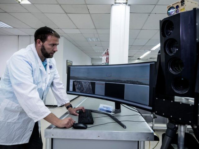 In this Monday, Sept. 9, 2019 photo, Ariel Gomez, a systems engineer at Israel Aerospace Industries, works on the Popstar system that can track and identify flying objects day or night without being detected, at Israel Aerospace Industries, in the Israeli town of Yehud near Tel Aviv. Israel has long …