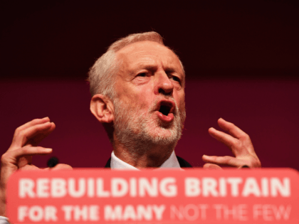 """LIVERPOOL, ENGLAND - SEPTEMBER 26: Labour Party leader, Jeremy Corbyn addresses delegates on day four of the Labour Party conference at the Arena and Convention Centre on September 26, 2018 in Liverpool, England. In his closing speech to the conference the Labour leader will promise to """"kickstart a green jobs …"""