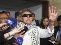 Former FARC rebel Jesus Santrich talks to journalists after swearing in to take his congressional seat in Bogota, Colombia, Tuesday, June 11, 2019. Santrich was unable to take up his seat in congress last year when he was jailed awaiting extradition to the U.S. on drug charges, but was released …