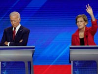Former Vice President Joe Biden, left, and Sen. Elizabeth Warren, D-Mass., right, Thursday, Sept. 12, 2019, listen during a Democratic presidential primary debate hosted by ABC at Texas Southern University in Houston. (AP Photo/David J. Phillip)