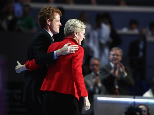PHILADELPHIA, PA - JULY 25: Sen. Elizabeth Warren (D-MA) embraces Rep. Joseph P. Kennedy, III (D-MA) (L) after being introduced on the first day of the Democratic National Convention at the Wells Fargo Center, July 25, 2016 in Philadelphia, Pennsylvania. An estimated 50,000 people are expected in Philadelphia, including hundreds …