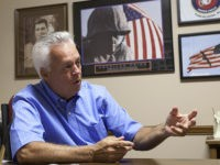 In this Aug. 9, 2011 photo, Johnny Spann talks with reporters in his Winfield, Ala., real estate office. Ten years ago Spann was a quiet small town real estate agent in Winfield in northwest Alabama. He's still selling real estate out of his storefront downtown office, but otherwise his life …