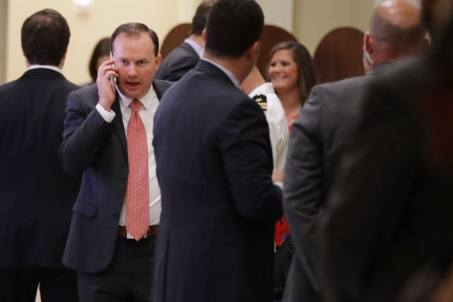 WASHINGTON, DC - JULY 18: Sen. Mike Lee (R-UT) takes a break from the weekly Senate Republican policy luncheon to talk on the phone outside the Mansfield Room at the U.S. Capitol July 18, 2017 in Washington, DC. Senate Majority Leader Mitch McConnell (R-KY) said there are not enough votes …