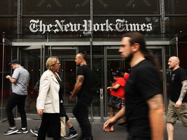 NEW YORK, NY - JULY 27: People walk past the New York Times building on July 27, 2017 in New York City. The New York Times Company shares have surged to a nine-year high after posting strong earnings on Thursday. Partly due to new digital subscriptions following the election of …