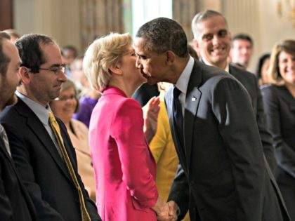 US President Barack Obama leans in to kiss Senator Elizabeth Warren (D-MA) after making a statement in the State Dining Room of the White House July 17, 2013 in Washington, DC. Obama spoke about the recent confirmation of Cordray, as the Director of the Consumer Financial Protection Bureau who was …