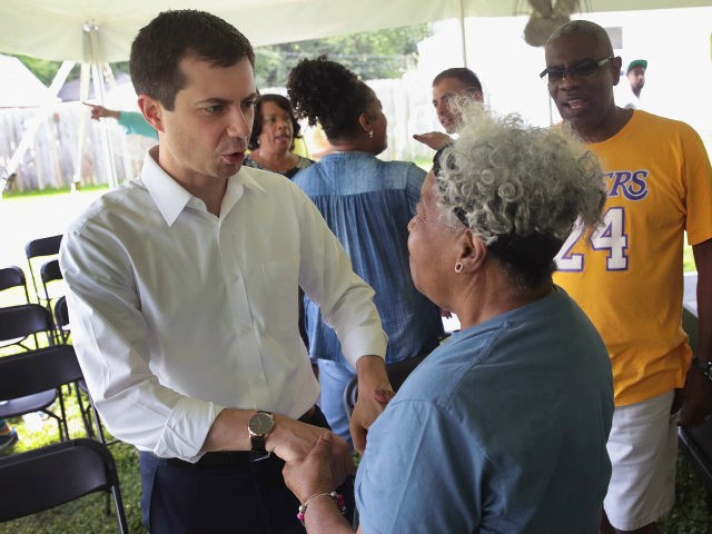Democratic presidential candidate and South Bend, Indiana mayor Pete Buttigieg greets residents during a community building event hosted by Christ Temple Apostolic Church on June 29, 2019 in South Bend, Indiana. The event was held as the funeral for Eric Logan was being held in nearby Mishawaka. Logan was shot …