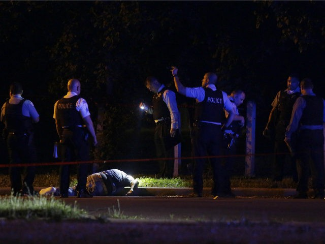 Chicago Police officer investigate the crime scene where a man was shot and killed on the Near West Side on July 2, 2017 in Chicago, Illinois. Local media reports that at least six people have been killed and dozens wounded in shooting as Chicago headed into July 3, and the …
