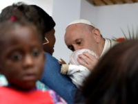 Pope Francis kisses a baby during his visit at Zimpeto Hospital, in Maputo, Mozambique, Friday, Sept. 6, 2019. Francis wrapped up his visit to Mozambique on Friday by consoling HIV-infected mothers and children at a Catholic Church-run hospital in one of the countries hardest hit by the AIDS epidemic, saying …