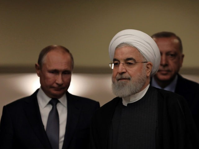 Turkish President Recep Tayyip Erdogan, right, Russia's President Vladimir Putin, left, and Iran's President Hassan Rouhani arrive for a news conference in Ankara, Turkey, Monday, Sept. 16, 2019. The leaders of Russia, Iran and Turkey met in the Turkish capital to discuss the situation in Syria, with the aim of …
