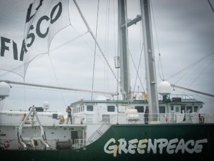 "Greenpeace activists raise a banner reading ""EPR, a fiasco"" aboard the Rainbow Warrior III ship as they take part in an action against the future Flamanville nuclear power plant (Evolutionary Power Reactor of Flamanville) off La Hague, in the English Channel, on August 16, 2019. - The Rainbow Warrior III …"