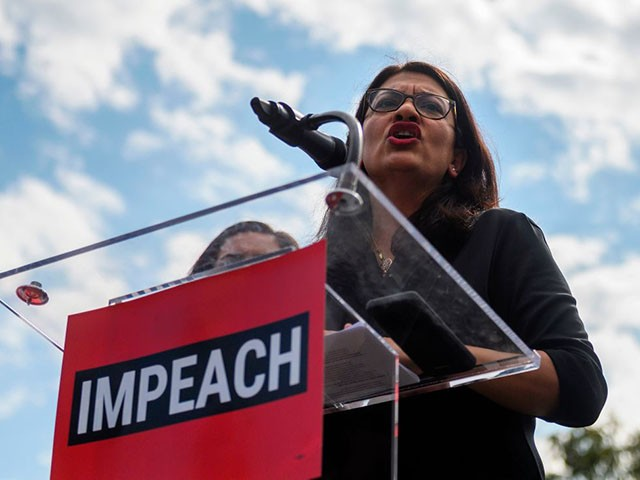 "Representative Rashida Tlaib (D-MI) speaks during the ""People's Rally for Impeachment"" on Capitol Hill in Washington, DC on September 26, 2019. - Top US Democrat Nancy Pelosi announced on September 24 the opening of a formal impeachment inquiry into President Donald Trump, saying he betrayed his oath of office by seeking help from a foreign power to hurt his Democratic rival Joe Biden. (Photo by ANDREW CABALLERO-REYNOLDS / AFP) (Photo credit should read ANDREW CABALLERO-REYNOLDS/AFP/Getty Images)"