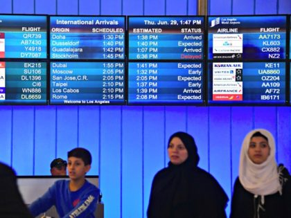 Travellers from the Middle East exit the International Arrivals section at Los Angeles International Airport on June 29, 2017, where free legal advice was offered and activists protested President Donald Trump's ban temporarily barring entry into the US from Libya, Iran, Somalia, Sudan, Syria and Yemen. The ban prevents the …