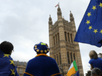 Pro-Europe supporters gather beside the Victoria Tower, where all the original documents created in over 500 years of the British Houses of Parliament are kept, in central London as protests continue outside the Palace of Westminster in central London on September 3, 2019. - The fate of Brexit hung in …