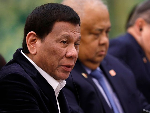 BEIJING, CHINA - AUGUST 30: Philippine President Rodrigo Duterte (L) speaks to Chinese Premier Li Keqiang (not pictured) during their meeting at the Great Hall of the People on August 30, 2019 in Beijing, China. (Photo by How Hwee Young-Pool/Getty Images)