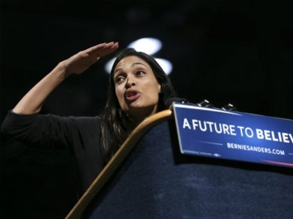 Actress Rosario Dawson looks out at the audience as she prepares to introduce Democratic presidential candidate, Sen. Bernie Sanders, I-Vt., at a campaign rally, Tuesday, April 12, 2016, in Syracuse, N.Y. (AP Photo/Mel Evans)