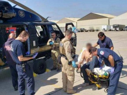 A San Diego Sector Air and Marine Operations aircrew and Border Patrol agents team up to rescue a migrant suffering from heat and dehydration. (Photo: U.S. Customs and Border Protection/San Diego Sector)