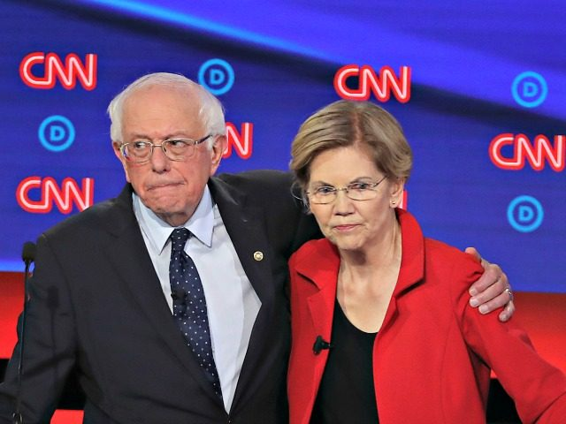 DETROIT, MICHIGAN - JULY 30: Democratic presidential candidate Sen. Bernie Sanders (I-VT) (L) and Sen. Elizabeth Warren (D-MA) embrace after the Democratic Presidential Debate at the Fox Theatre July 30, 2019 in Detroit, Michigan. 20 Democratic presidential candidates were split into two groups of 10 to take part in the …