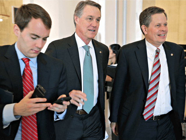 WASHINGTON, DC - FEBRUARY 04: Sen. David Perdue (R-GA) (C) and Sen. Steve Daines (R-MT) (R) leave a Senate bipartisan lunch in the Russell Senate Office Building on Capitol Hill February 4, 2015 in Washington, DC. Senators from both parties said they did not talk about current legislation during the …